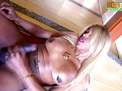 Suzanna Holmes is a horny ebony tgirl with a curvy body, big boobs and a HUGE hard dick! Watch her stroking her big tool hard until she cums!