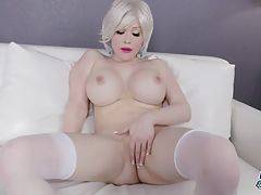 Sarina has a smoking hot body, big boobs, a juicy round ass and a rock hard cock! Watch this beautiful tgirl stroking her dick!