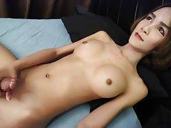 Mikky is a stunning 21 year old ladyboy from Bangkok. She is tall, slim, fake boobs, very cute face and a big, glorious and rock hard cock that cums big and powerful loads.