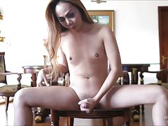 Long hair Judy puts on a private stroking show! Amy sets up the camera and lets Judy do what she wants. Judy slides off her panties and caresses her cum-full balls. Her long cock dangles then grows fully erect. Judy strokes with her dress above her waist,