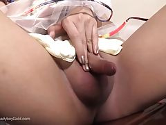 Her lady penis is hard instantly as she lifts up her dress for the first time.. and she`s just only a lollipop.
